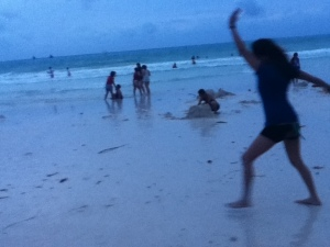 me, attempting a cartwheel at the shore.